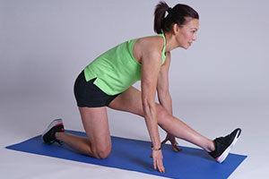 Kneeling hamstring stretch demonstration.