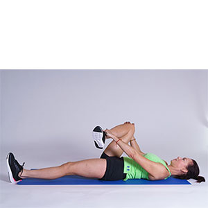 Laying glute stretch demonstration.