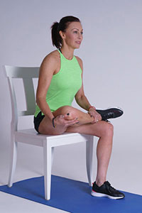 Seated band stretch demonstration.