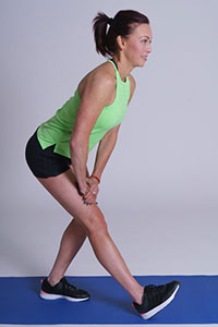 Standing hamstring stretch demonstration.