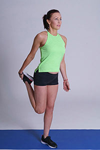 Standing quad stretch demonstration.